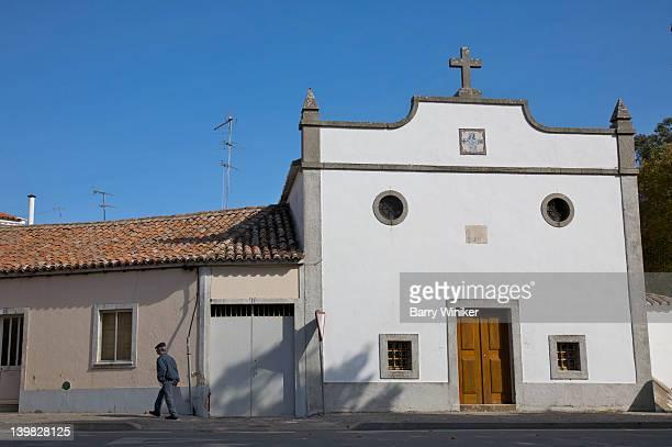 man on street near church in monchique, built 1940, in the algarve, near portimao, portugal  - モンシケ ストックフォトと画像