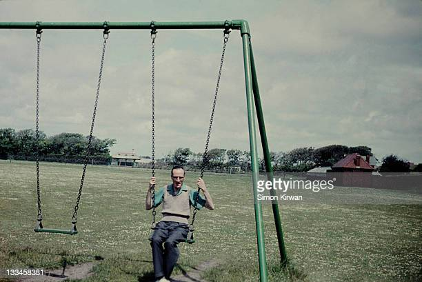 man on swing - 1961 stock pictures, royalty-free photos & images