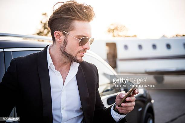 Man on the airport holding mobile phone