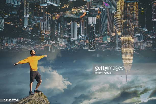 a man on the background of the city. conceptual image - upside down stock pictures, royalty-free photos & images
