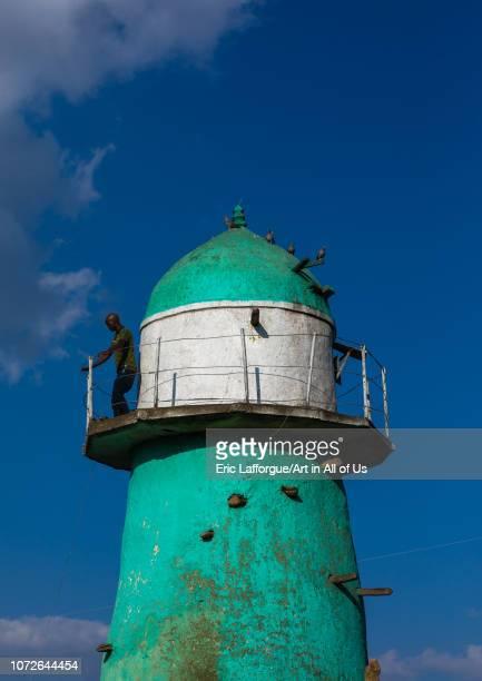 Man on the balcony of the dengogo mosque green minaret Harari Region Dengogo Ethiopia on November 3 2018 in Dengogo Ethiopia