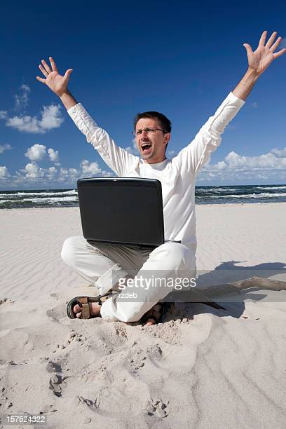 Man on the Beach with Laptop - success