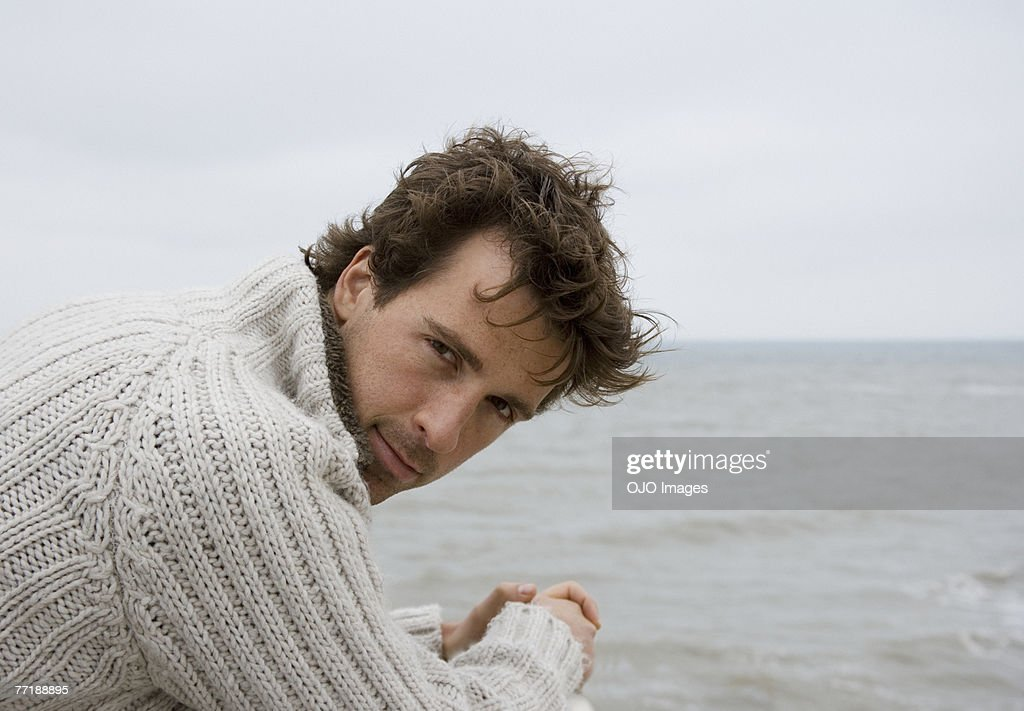 A man on the boardwalk at the beach : Stock Photo