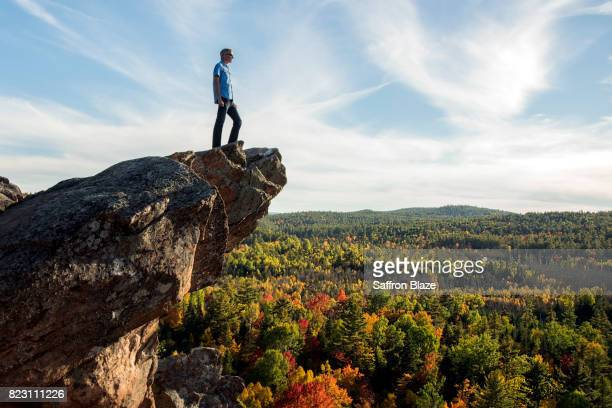 A man on the edge of a cliff.