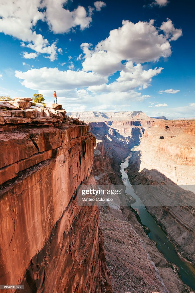 Man on the edge of overlook on Grand Canyon, USA : Stock Photo