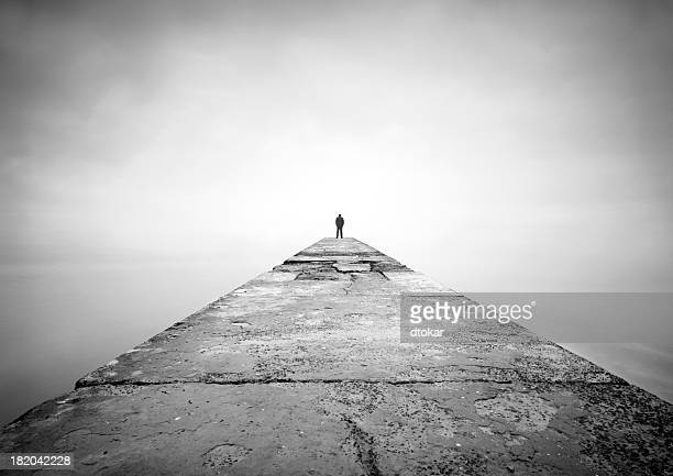 man on the edge of pier - grief stock pictures, royalty-free photos & images