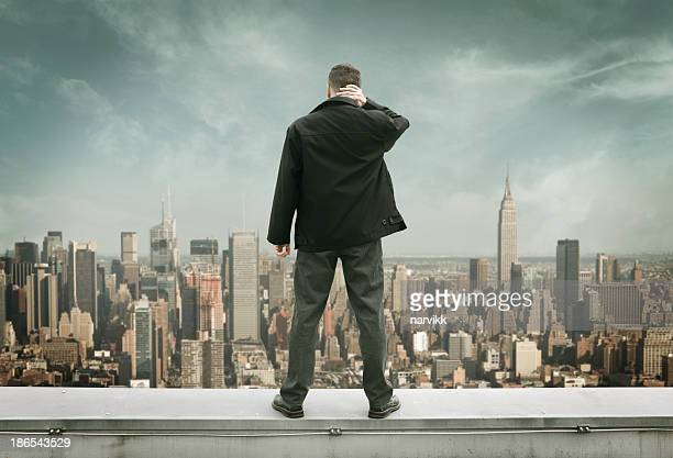 man on the edge - suicide stock photos and pictures