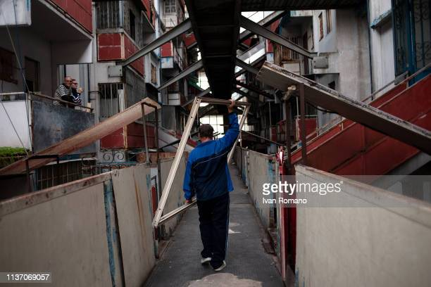 A man on the gallery inside the red sail on November 17 2016 in Naples Italy The Brutalist apartment blocks known as Le Vele or 'The Sails Of...