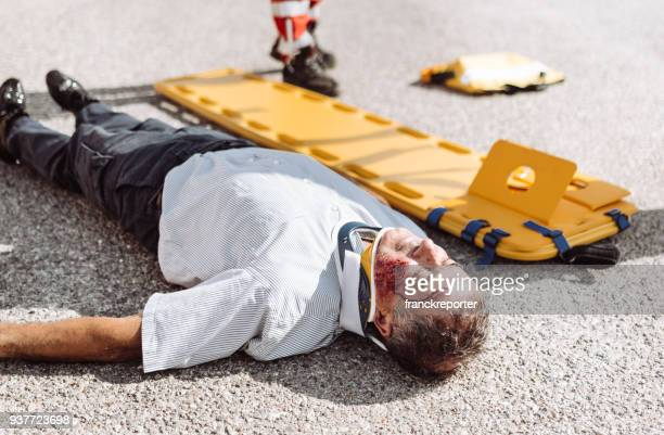 man on the ground after a car crash - motorcycle accident stock pictures, royalty-free photos & images