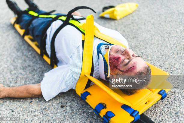 man on the ground after a car crash - victim stock pictures, royalty-free photos & images