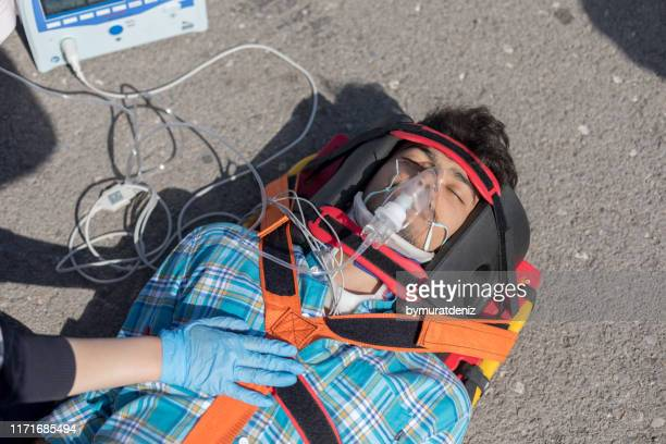 man on the ground after - rescue worker stock pictures, royalty-free photos & images
