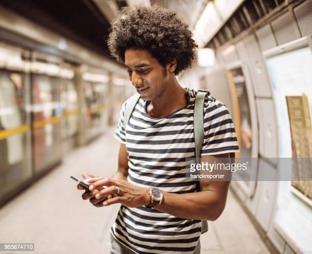 hombre en el metro de londres en el teléfono - vertical red tube fotografías e imágenes de stock