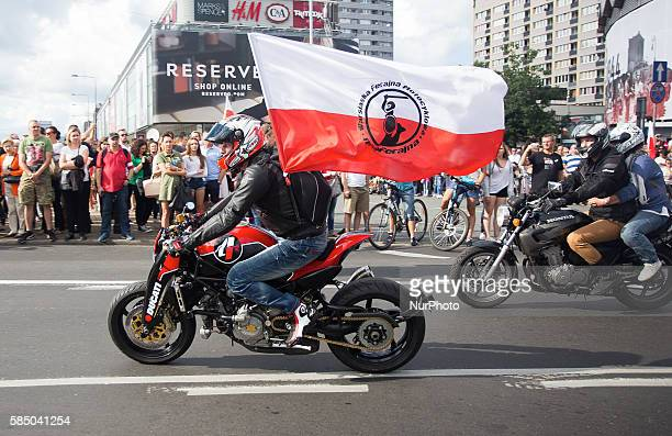 Man on the motorcycle with Polish flag with the sign of the Warsaw Uprising in Warsaw 01 Aug Poland