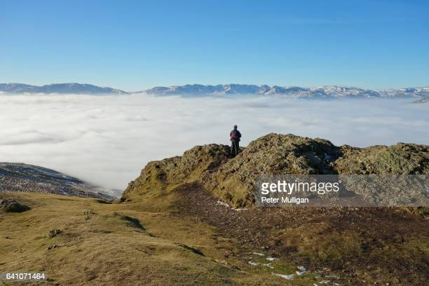 man on the mountain top, english lake district. - weitwinkelaufnahme stock-fotos und bilder