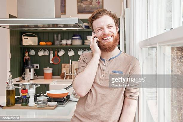 Man on the phone at home