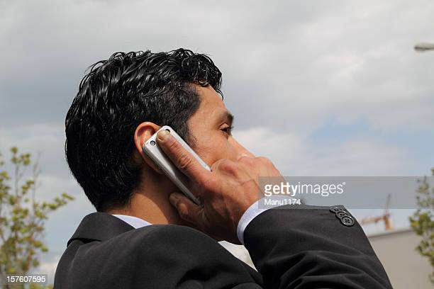 man on the phone - bringing home the bacon stock photos and pictures