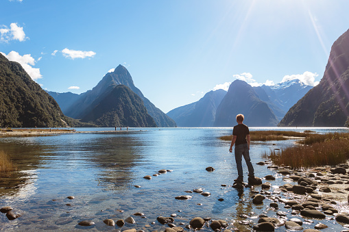 Man on the shore, Milford sound, New Zealand - gettyimageskorea