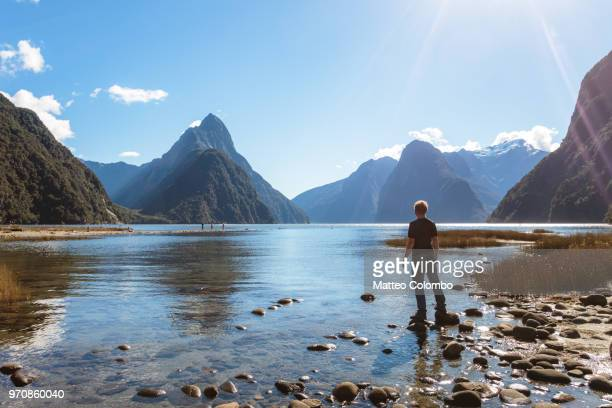 Man on the shore, Milford sound, New Zealand