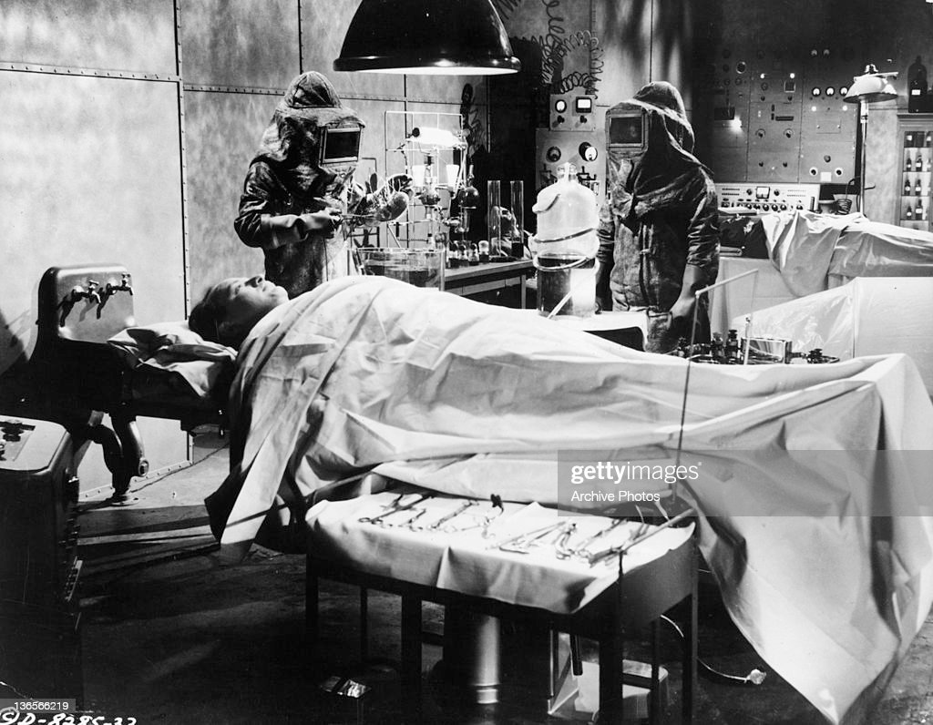 Man on the table about to be operated on in a scene from the film 'Creature With The Atom Brain', 1955.