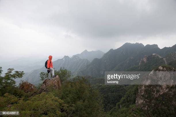 man on the top of mountaion