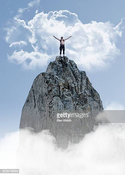 man on top of a mountain. - stubborn stock pictures, royalty-free photos & images