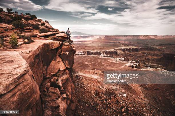 man on top of canyonlands