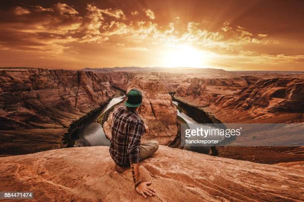 man on top of horse shoe bend
