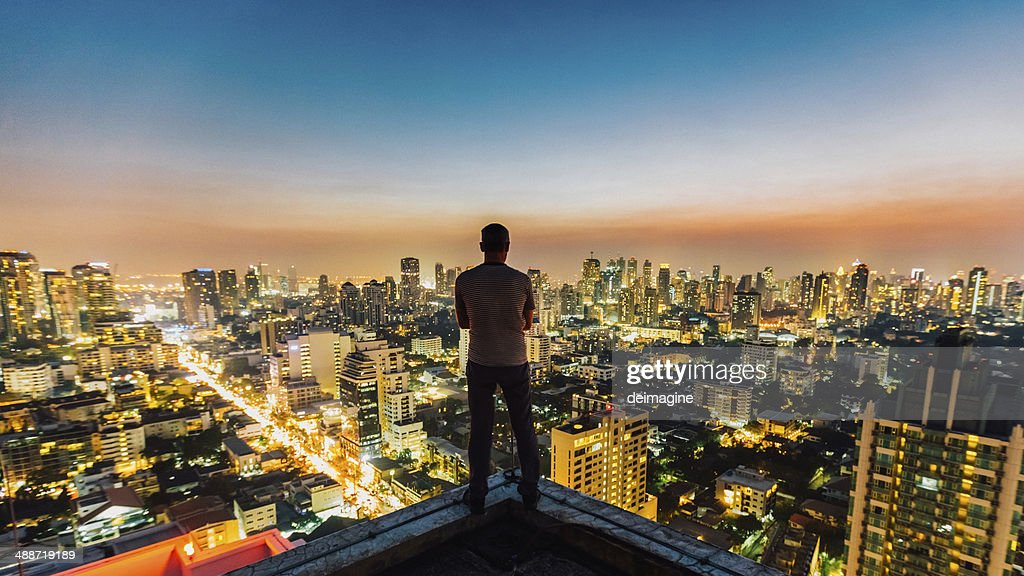Man on top of skyscraper : Stock Photo