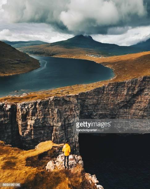 man on top of the cliff at Faroe islands