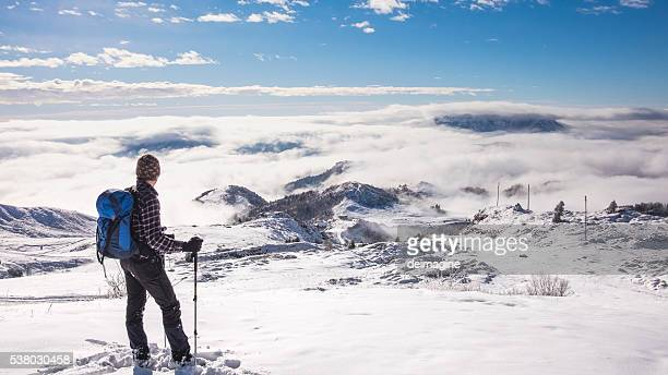 Man on top of the mountain snowy