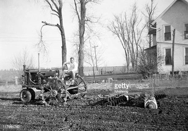 man on tractor disking 1941, retro