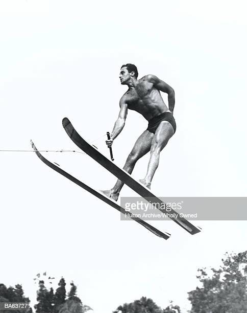 Man on waterskies doing jump (B&W)