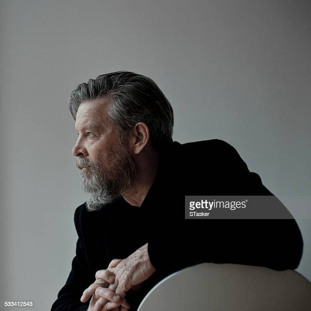 Man on white chair