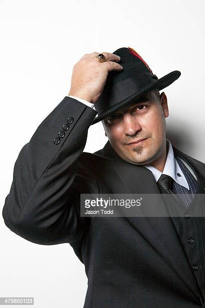man on white tipping hat wearing suit and tie