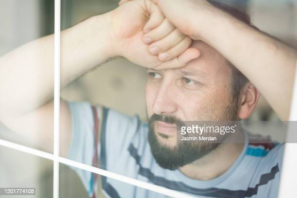 man on window - avoidance stock pictures, royalty-free photos & images