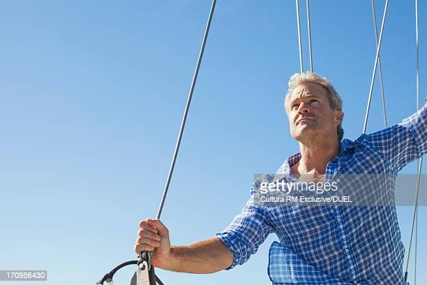 Man on yacht looking away