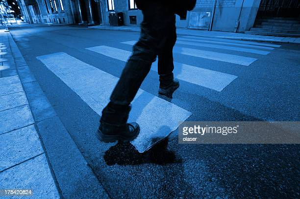 Man on zebra crossing in the middle of night