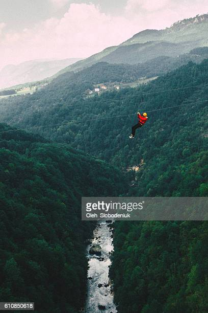 Man on zip line under the Tara river