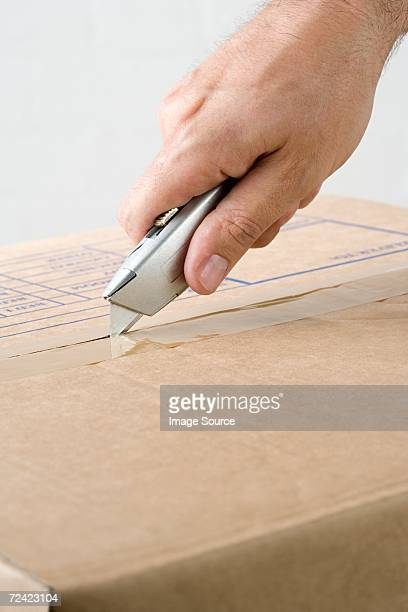 man opening box - utility knife stock pictures, royalty-free photos & images