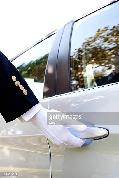 Man opening car door with gloved hand, close-up
