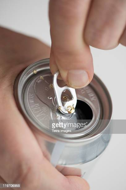 Man opening drink can