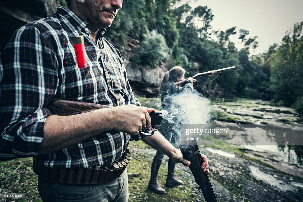 Man opening gun : Stock Photo