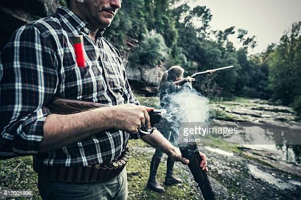 Man opening gun