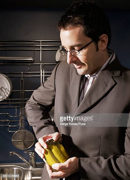 Man Opening Jar of Pickles