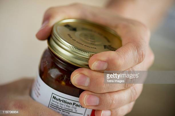 man opening jar - jar stock pictures, royalty-free photos & images