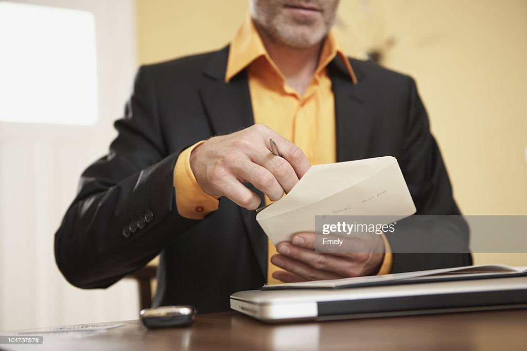 Man opening letter : Stock Photo