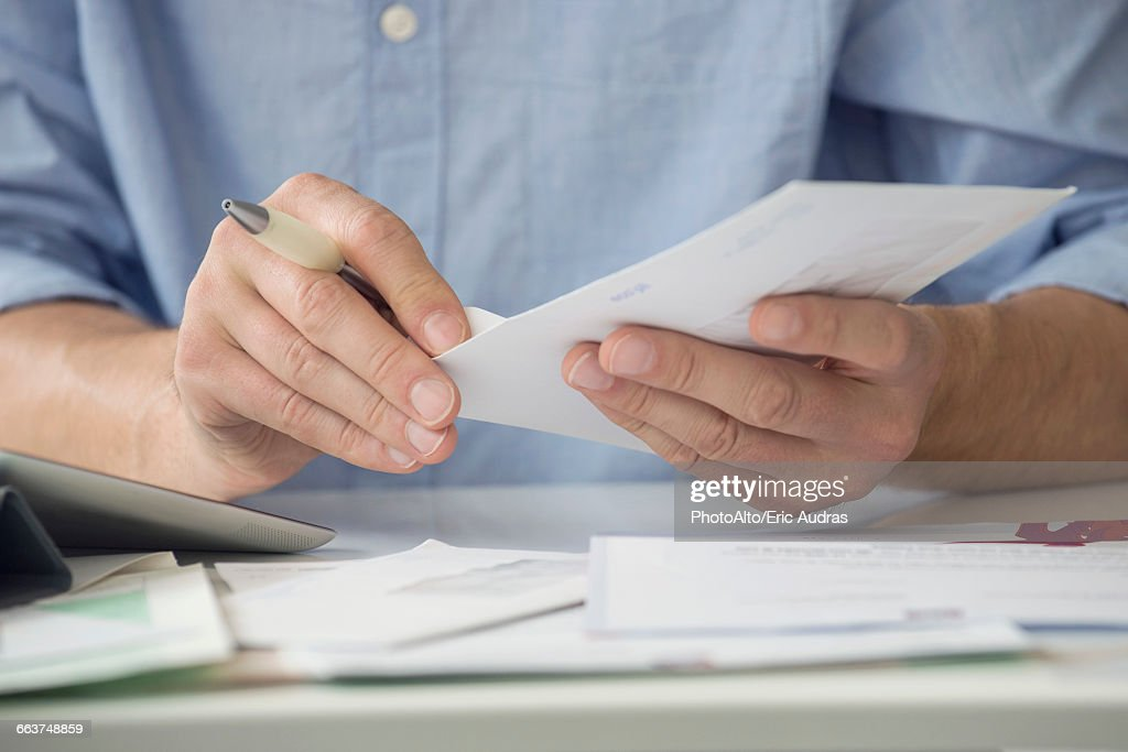 Man opening mail : Stock Photo