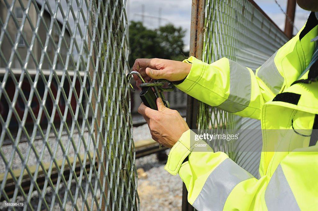 Man opening padlock : Stock Photo
