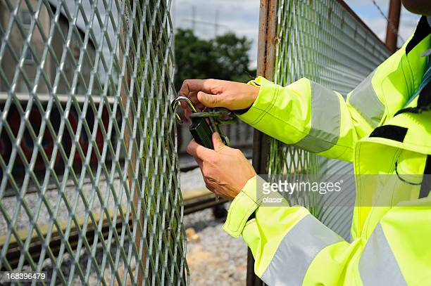 man opening padlock - locking stock pictures, royalty-free photos & images