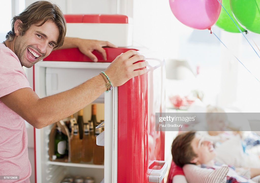 Man opening refrigerator : Stock Photo